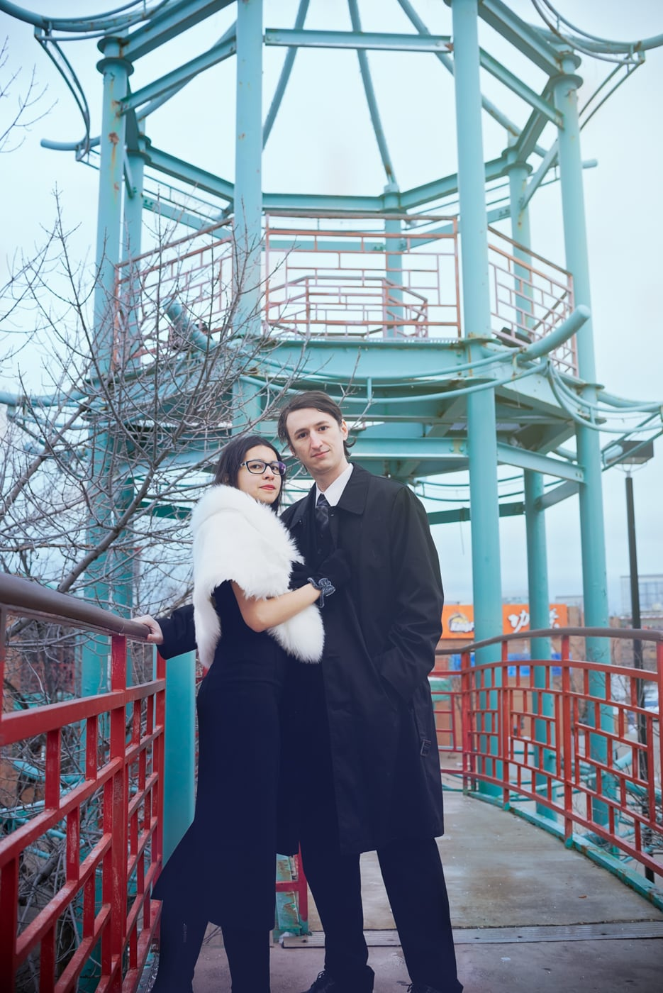 A contemporary and creative portrait session of a couple in Chicago. Wearing 1940's and 1950's film noir inspired fur stole, black dress, and gloves. Chinatown at Archer avenue photography.